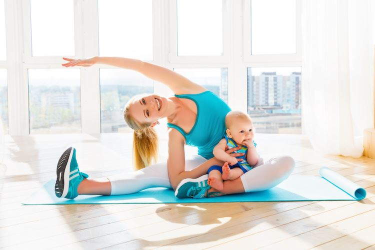 Mother and child doing yoga together